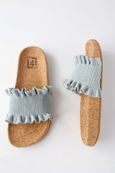 There is only one word to describe our feelings toward the LFL Alexa Denim Slide Sandals, and it is OBSESSED! A smocked, denim toe strap has cute, ruffled trim. A trendy, cork insole completes the spring chic look. Available in whole sizes only.