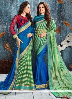 This delightful diva accoutre features unique styling and unusual material. Get the simplicity and grace with this blue and sea green silk classic designer saree. The lovely embroidered and patch bord...