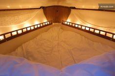 Teeny Tiny Seattle-Area Rentals To Get Cozy In Cozy V-berth idea! MoreCozy V-berth idea! Sailboat Decor, Sailboat Interior, Sailboat Living, Living On A Boat, Yacht Interior, Sailboat Yacht, Star Mobile, Boat Storage, Boat Projects