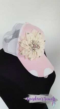 """Very high quality trucker hat. Pink and white with ivory bling flower. Each rhinestone is hand-sewn! As sold in Buckle. Brand is Olive and Pique. Buy it now at Jourdan's Jewels. Use code """"PINTEREST"""" to save 10%."""