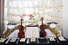 Amazing backdrop and dessert table at a music themed wedding party! See more party planning ideas at CatchMyParty.com!