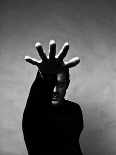 © Rahi Rezvani - man with outstretched hand - black and white photo - #S0FT PIN MIX