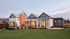 Village House by GLOW design was designed to be a ranch style house which had a strong link to its landscape were layout takes full advantage of its views. Board And Batten Cladding, Gable House, External Cladding, Village Houses, Village House Design, Corner House, Ranch Style Homes, Building Design, Building Ideas
