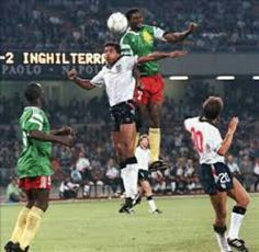 England 3 Cameroon 2 in 1990 in Naples. Francois Omam-Biyik gets up to beat Des Walker in the World Cup Quarter Final.