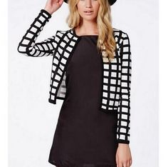 """$33.49  This plaid cropped jacket has a vintage look that you're going to love. Pair it with a dress as we show here, with a pair of slacks, or even with a skirt. No matter what you wear this black and white plaid cropped jacket with, you will look chic and stylish. Just click the""""Add To Cart""""Button Below! There's a very limited stock, and they will go soon! Note: Please allow 2-4 weeks for delivery. Multiple items in the same order may arrive in separate packages."""