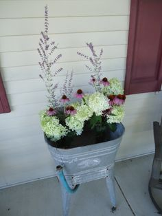 Cut flowers from my yard look great in the antique wash tub on my front porch.