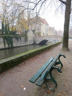 Dragon-headed benches along the canal in Bruges, Belgium