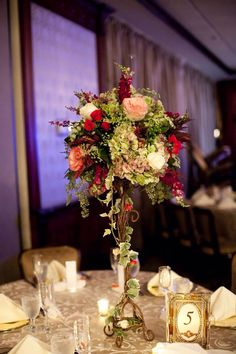 Tall gold stand floral centerpieces by Black Dahlia Inc. DIY vintage frame and keyhole table numbers. Picture by White Pear Photography. Long Island Wedding. The Woodlands at Woodbury.