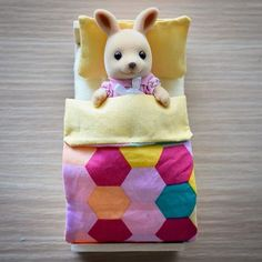 First mini bedding I've ever made Little K seems pleased with her new bed too!       #theminihouse #dollhousereno #dollhouserenoperth #miniatures #whatimade #kidsroom #kidsdecor #justdollfurniture #sylvanianfamilies #calicocritters #kangaroo #family #perthcreatives #bedding #handmade #perthkids