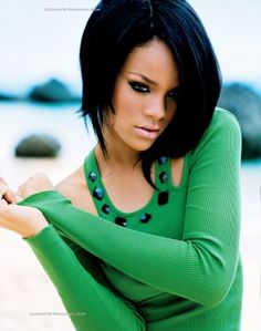 Rihanna - She is beautiful and I especially love this picture because of the beautiful green shirt, her dark hair, and the hair cut. #haircolour