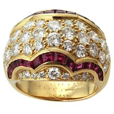 This gorgeous Van Cleef & Arpels ring is pave-set with sparkling round diamonds elegantly edged with square calibre-cut rubies chanel-set in 18k yellow gold. Circa 1989.