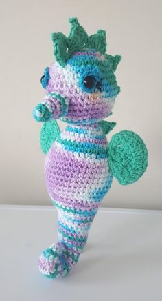 """This is Sheldon the Seahorse. He is roughly 12"""" tall. This 5 page written crochet pattern is in English using UK crochet terminology and includes detailed instructions with photos to guide you through the pattern.HAPPY CROCHETING!!!Level: intermediate - the pattern uses picot stMaterials needed: 4mm hook Worsted weight/Aran cotton yarn (Drops Paris and Lily's sugar and cream cotton yarn) Fiberfiller Safety eyes Darning needle"""