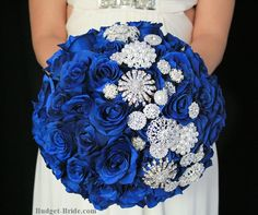 Royal Blue Rose and Brooch Bouquet, packages starting as low as $100.