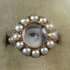 In the late 1700s George IV of England's lover gave him a locket with a miniature painting of her eye. The idea behind Lover's eyes jewellery is that the anonymity of the loved one is preserved, while eye contact maintained. (Gee, why would they need anonymity? Affairs much?)