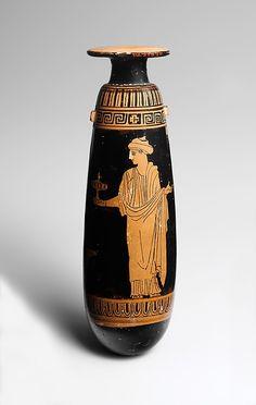 Terracotta alabastron (perfume vase)  Attributed to the Persephone Painter     Period:      Classical  Date:      ca. 440 B.C.  Culture:      Greek, Attic  Medium:      Terracotta  Dimensions:      H. 6 13/16 in. (17.3 cm) diameter 2 in. (5.1 cm)  Classification:      Vases