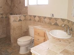 bathroom in Aurora with a handicap accessible shower, tiled walls, and new matching sink and vanity