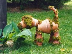 Flowers Gardens: Recycles clay pots & moss. My dogs would flip hahaha