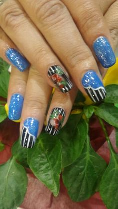 # nails # gel polish # nail art # one stroke # line design # blue # black # flowers # winter