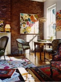 Bohemian design - lots of floral prints and art mixed with unique pieces. Brick accent wall and vintage chandelier.