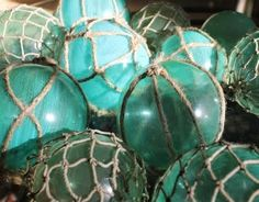 DIY  painted glass ornaments wrapped with fishing rope netting