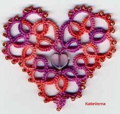 Tatting.  See the heart jewelry finding in the middle?  Nice.