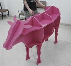 pink cow shelves for Erin Cracchiolo may be with cardboard for the classroom.