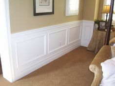 Another cream/sand with white wainscoting.