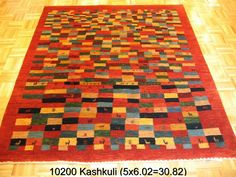Kashkuli, 5 x 6-2 by A Rug For All Reasons   This tribal Persian from southwest Iran has a folk or primitive feel due to the quirky and interesting design that was woven spontaneously from the weaver's imagination. These rugs are now rare due to the fact that Persian rugs are no longer being imported into the U.S. Natural dyes/handspun wool.