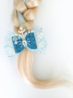 The Elsa Hair Bow Glitter Elsa Hair Bow by OrangeYouPeachy Disney Bows, Disney Hair, Ribbon Hair, Ribbon Bows, Frozen Bows, Elsa Hair, Glitter Hair, Glitter Dress, Silver Glitter