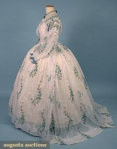 "PRINTED VOILE DAY DRESS, 1860s 2-piece white w/ green & brown floral pattern, trimmed w/ aqua ribbon & lace, DLM, B 40"", W 29"", Front L 42"", Back L 53"", (period mends in skirt) excellent."