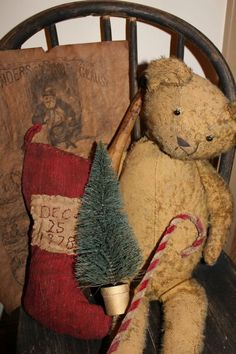 Christmas Prims...tattered teddy in an old chair...with a cane, tree, & stocking.
