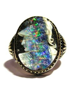 Achilles. Carlo Giuliano ring, opal cameo by Wilhelm Schmidt (1845-1938). Schmidt introduced a process of cutting opal cameos to utilize the matrix for the ground color. He carved his cameos from the newly discovered boulder opal variety found in Queensland, Australia, in the early 1870's. His cameos were exhibited in the 1878 Paris Exhibition by John Brogden and received a gold medal. Via Wartski, London