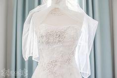 The bride's dress awaits the ceremony. Photo by http://katiekaizerphotography.com/