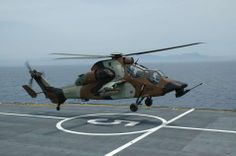 Eurocopter EC 665 Tigre attack helicopter of French Armée de Terre landing in a French frigate, during joint exercises.