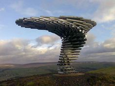 "The Singing Ringing Tree Atop a barren hilltop in Lancashire, England, stands this most unusual musical sculpture. Designed by architects Mike Tonkin and Anna Liu, the ""tree"" is comprised of a series of pipes, cut and stacked in a spiral fashion. Sound Sculpture, Tree Sculpture, Sculpture Ideas, Pink Floyd Albums, England, Metal Tree Wall Art, Metal Art, Tree Wall Decor, Art Decor"