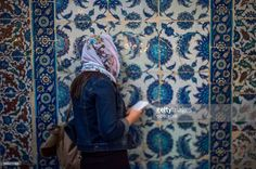 TOPSHOT - A Muslim worshipper prays as she waits to break her fast on June 21, 2017 outside the Eyup Sultan mosque on the occasion of Laylat al-Qadr which falls on the 27th day of the fasting month of Ramadan. Laylat al-Qadr, or Night of Destiny, marks the night Muslims believe the first verses of the Koran were revealed to the Prophet Mohammed through the archangel Gabriel. / AFP PHOTO / OZAN KOSE        (Photo credit should read OZAN KOSE/AFP/Getty Images)