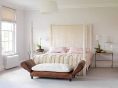 an old sofa becomes a bench at the foot of the bed... shabby chic bedroom