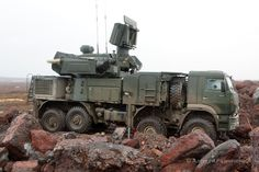 """""""Pantsir-S1 (NATO reporting name SA-22 Greyhound) is a combined short to medium range surface-to-air missile and anti-aircraft artillery weapon system produced by KBP of Tula, Russia. The system is a further development of SA-19/SA-N-11 and represents the latest air defence technology by using phased-array radars for both target acquisition and tracking"""". – Wikipedia"""