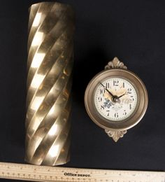 BRASS SMALL CLOCK BY CAFE DES ROSES AND VASE