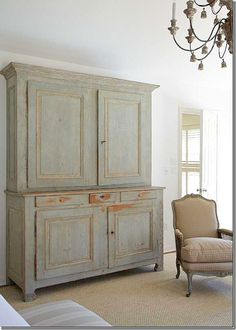 A view of the French armoire in aqua peeling paint...home of Carol Glasser