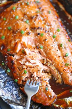 Asian Salmon in Foil recipe. The best and easiest way to make salmon in foil and you won't believe how much flavor is packed right in!