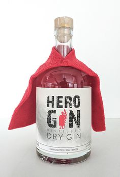 The hero has done well. With a red cape comes the hero gin on our D . Bottle Packaging, Bottle Labels, Liquor Bottles, Drink Bottles, Whiskey Bottle, Vodka Bottle, Best Gin Cocktails, Gin Festival, Gins Of The World