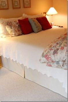 Super Easy DIY Bedskirt (out of curtain panels!)