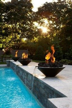 Poolside firepits...OMG these are the ones, this is what we were meant to build ....the firepit gods are whispering to me they say build me have Rhonda build me thats what they are saying,..lol...totally awesome and elegaunt....