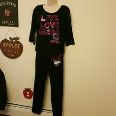 Aeropostale outfit Aeropostale live love dream black sweatshirt with 3/4 length sleeves & kangaroo pocket. Matching black sweatpants with drawstring waist, elastic cuff ankles, pink aero sequins on front, pink sequin heart with peace sign on right rear & pink 87 on left rear. Both are pre owned with no stains, holes or defects. Smoke free, pet free home. Aeropostale Pants Track Pants & Joggers