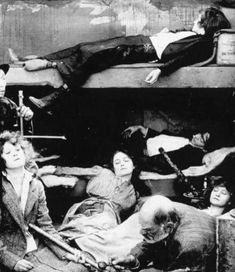 Western men and women of upper and middle class means frequentes opium dens like this one, 1923. — in New York, New York.