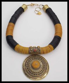 ONE OF A KIND! Exquisitely detailed, 3-dimensional, handmade hinged Tibetan brass pendant hangs from necklace made of old African vulcanite