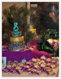 craziness!!! Love the peacock feathers behind the cake though.
