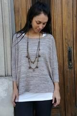 Boxy is a very simple modern sweater, with a wide body and skinny sleeves. Knit usinga lightweight yarn at a looser gauge, it is flattering, drapey and stylish! A little short row section in the shoulders adds an interesting texture to the sleeves. Directions are given to make a seamless version (worked in the round)