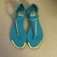 DV by Dolce Vita Thong Sandals Great Condition DV Dolce Vita Sandals! Open toe flat thong sandals with a metal kick plate at toe and trim at vamp strap. Adjustable buckle at ankle strap. Man made sole. DV by Dolce Vita Shoes Sandals